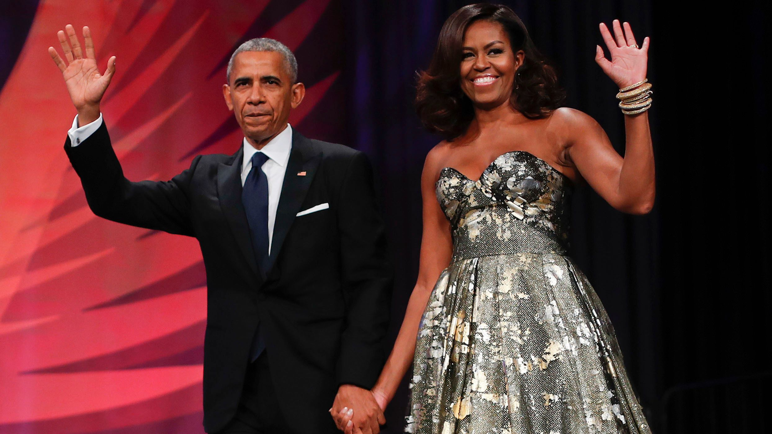FILE - This Sept. 17, 2016 file photo shows President Barack Obama and first lady Michelle Obama at the Congressional Black Caucus Foundation's 46th Annual Legislative Conference Phoenix Awards Dinner in Washington. The former president and first lady have signed with Penguin Random House, the publisher announced Tuesday, Feb. 28, 2017. (AP Photo/Pablo Martinez Monsivais, File)