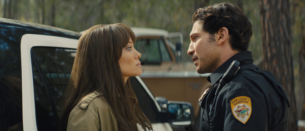 """This image released by Warner Bros. Entertainment shows Angelina Jolie, left, and Jon Bernthal in a scene from """"Those Who Wish Me Dead."""" (Emerson Miller/Warner Bros. Entertainment via AP)"""