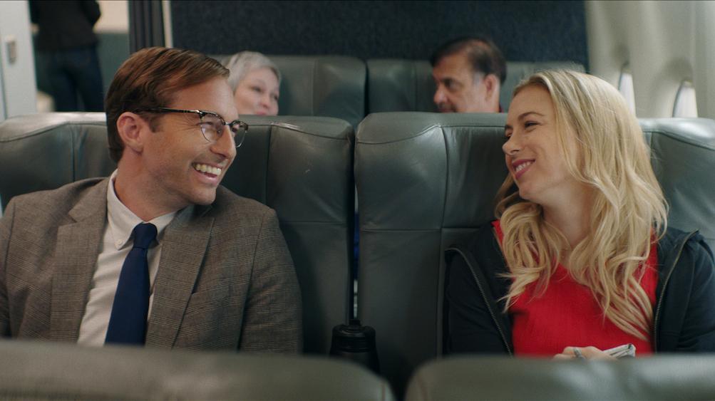 GOOD ON PAPER (2021) Ryan Hansen as Dennis Kelly and Iliza Schlesinger as Andrea Singer. Cr: NETFLIX