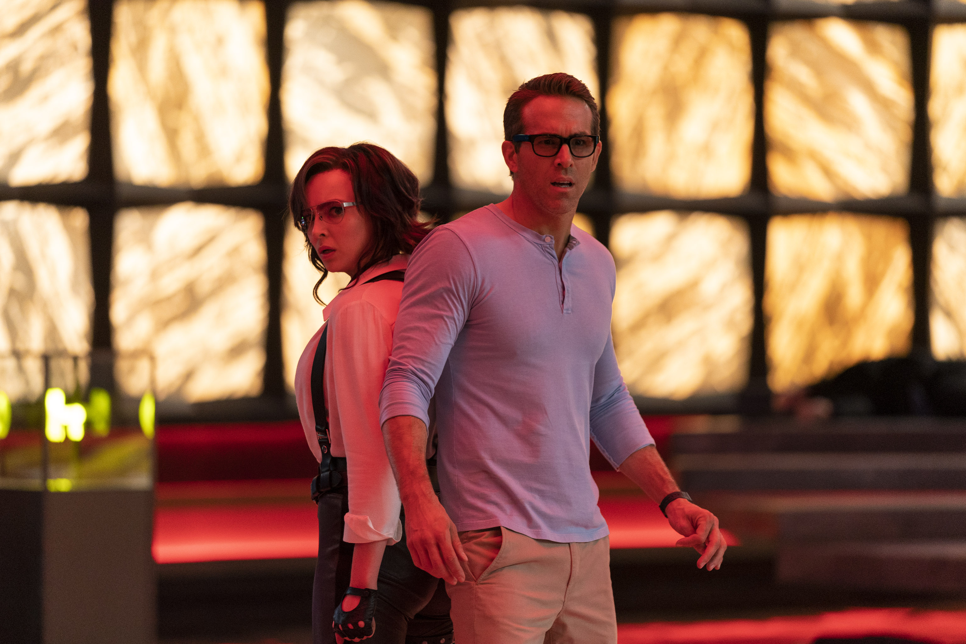 """Jodie Comer (left) and Ryan Reynolds in a still from the new movie """"Free Guy."""""""